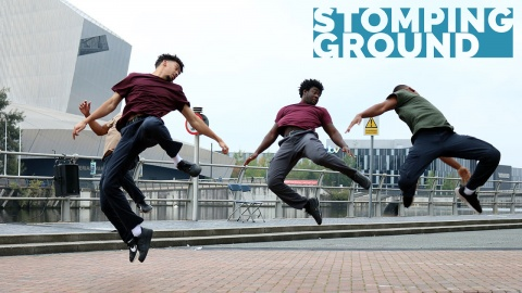 Three male dancers jumping in an urban environment