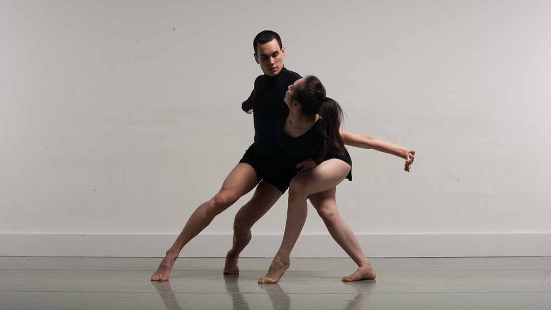 A full colour image showing a male and female dancer performing, image Chris Nash