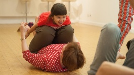 Summer Dance Course for Young People at The Place - girl dancing and smiling with her mum