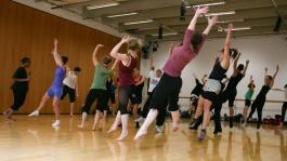 Dance Class, The Place - Students jump simultaneously stretching both hands upwards
