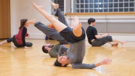 Dance classes for adults, The Place - female student rolls on her back on the floor